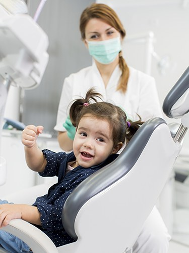 Smiling young girl in dental chair