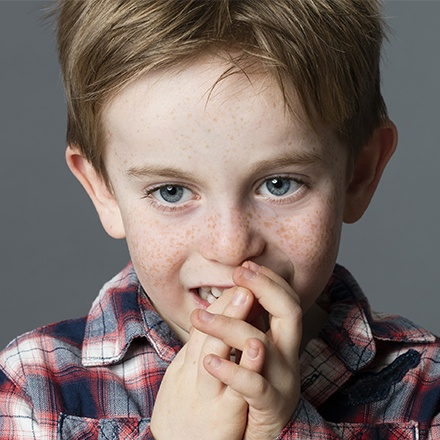 Child chewing on fingers