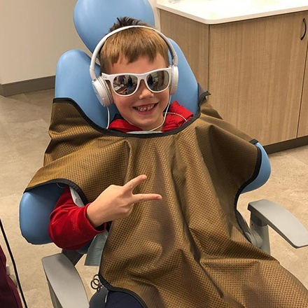 Little boy smiling in dental chair