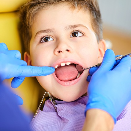 Young boy receiving dental exam