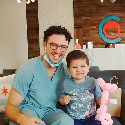 Dr. Justin smiling with young patient