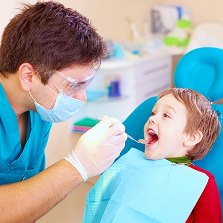 Little boy receiving dental exam